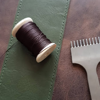 hand stitching leather notebook cover
