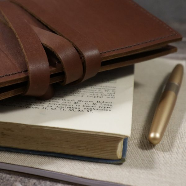 cognac leather notebook cover with tie usage