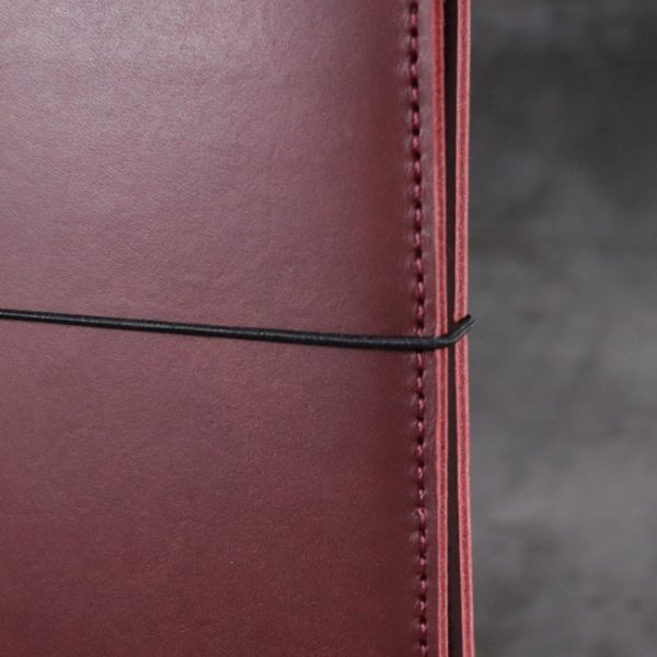 leather notebook cover elastic mahogany closeup