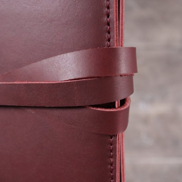 leather notebook cover tie mahogany closeup