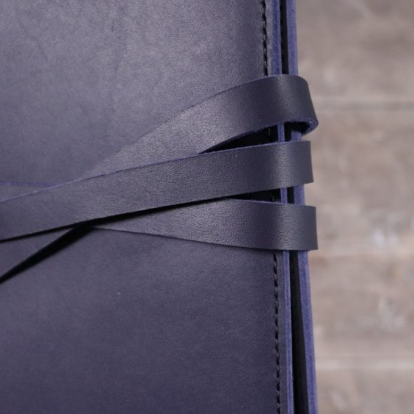 leather notebook cover tie navy closeup