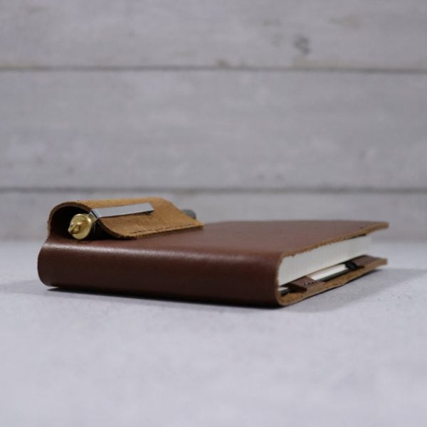 leather reporter flip notebook cover cognac angle view