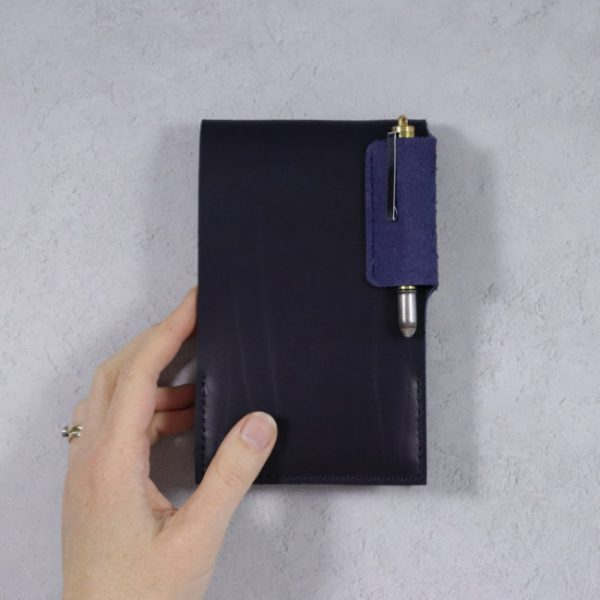 leather reporter flip notebook cover navy hand on light