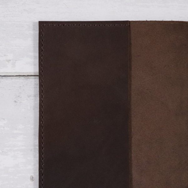 mocha leather stillman and birn hardcover hand stitch detail