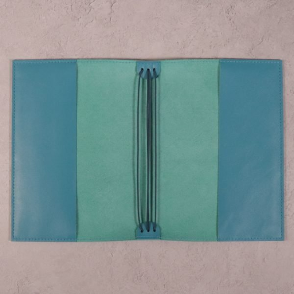 teal blue leather journal open