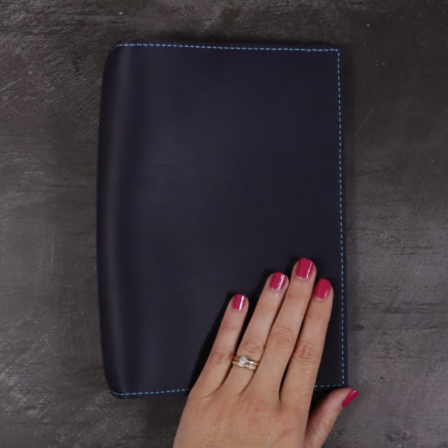 A5 navy and teal leather notebook closed hand 2