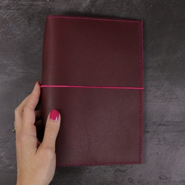 A5 red and fuchsia leather notebook closed elastic hand