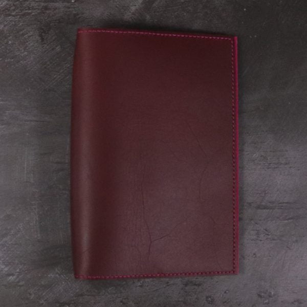 A5 red and fuchsia leather notebook closed none