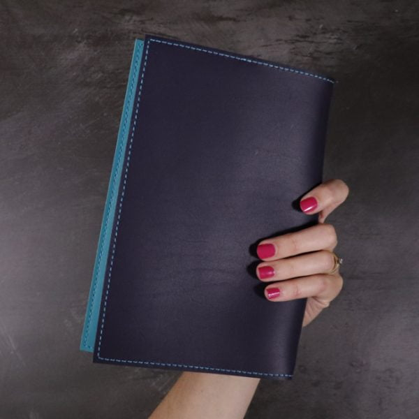 navy and teal leather notebook closed hand