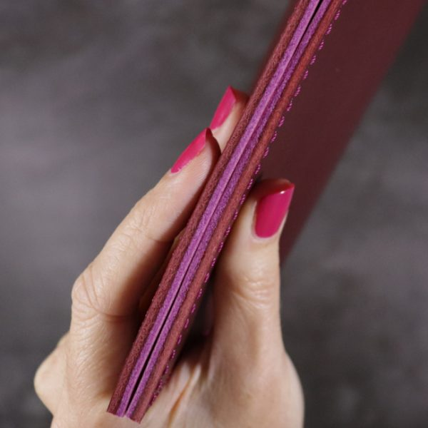 red and fuchsia leather notebook detail 3