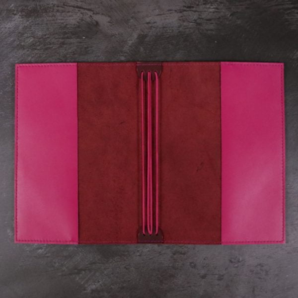 red and fuchsia leather notebook open
