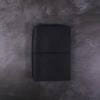 A6 black leather journal with elastic closure