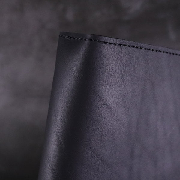 black leather notebook cover spine detail