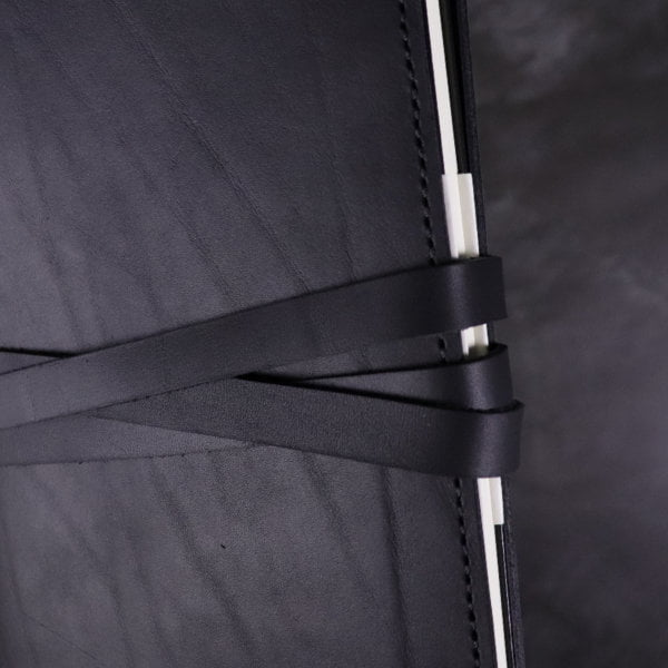 black leather notebook cover tie detail 2